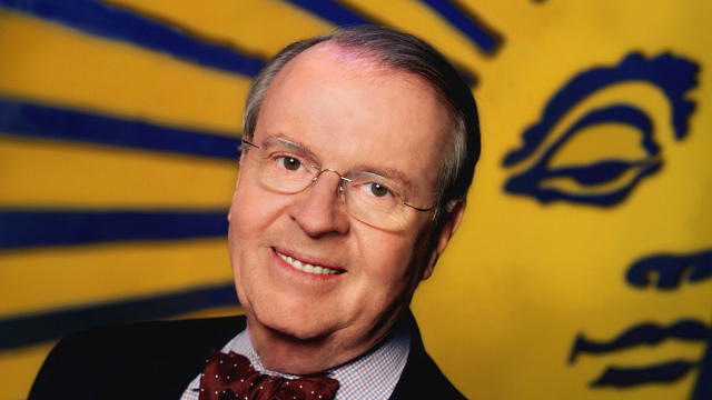 caption: Celebrating 25 years of CBS NEWS SUNDAY MORNING, anchor Charles Osgood catches some of the show's signature rays on the set after a recent broadcast. The show will reach its milestone broadcast on January 24, 2004. Photo: John Filo/CBS ©2005 CBS Broadcasting Inc. All Rights Reserved copyright: